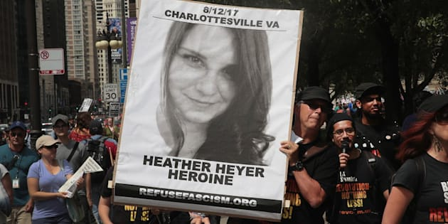 CHICAGO, IL - AUGUST 13:  A demonstrator carries a sign remembering Heather Heyer during a protest  on August 13, 2017 in Chicago, Illinois. Heyer was killed and 19 others were injured yesterday in Charlottesville, Virginia when a car plowed into a group of activists who were preparing to march in opposition to a nearby white nationalist rally. Two police officers were also killed when a helicopter they were using to monitor the rally crashed.  (Photo by Scott Olson/Getty Images)