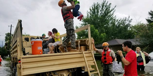 Texas National Guard soldiers aid residents in heavily flooded areas in Houston.