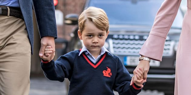 Prince George holding hands with the Duke of Cambridge and Helen Haslem, head of the lower school, at Thomas's Battersea in London, as he starts his first day of school.