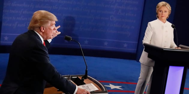 Then-Republican presidential nominee Donald Trump speaks as then-Democratic presidential nominee Hillary Clinton looks on during the final presidential debate on Oct.19, 2016.