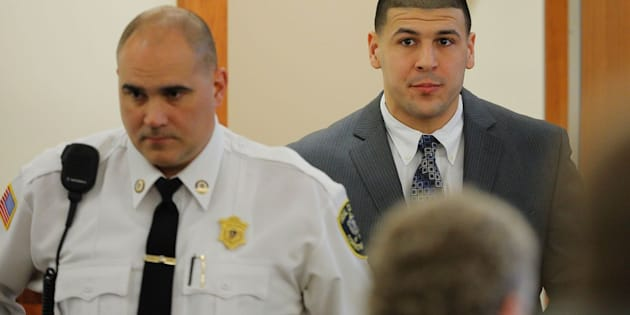 Former New England Patriots football player Aaron Hernandez arrives in the courtroom at Bristol County Superior Court in Fall River, Massachusetts, on April 1, 2015.