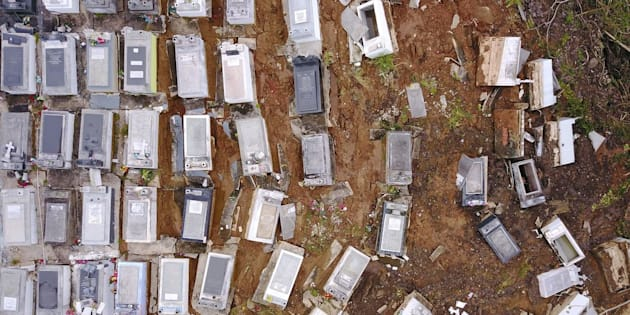 Coffins were washed downhill from the Lares Municipal Cemetery by a landslide in the wake of Hurricane Maria in Puerto Rico.