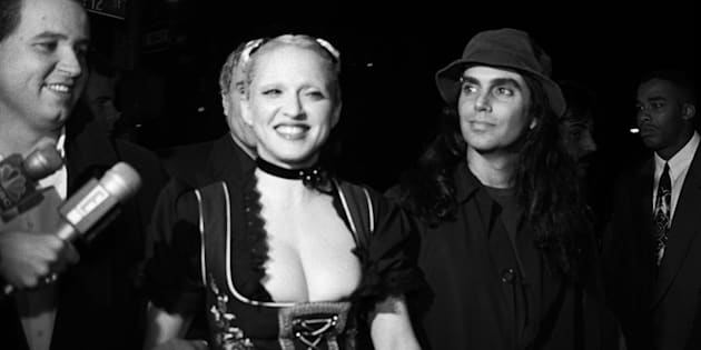 """Madonna and photographer Steven Meisel arrive at a New York party for """"Sex"""" on Oct. 15, 1992."""