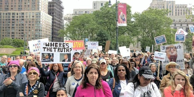 Hundreds of demonstratorsin New York City took to the streets Saturday to protest President Donald Trump's ties with Russia.