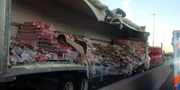 Police say cleanup efforts are underway after a transport truck collision that spilled yogurt onto a busy stretch of Hwy. 401 in Toronto's east end.