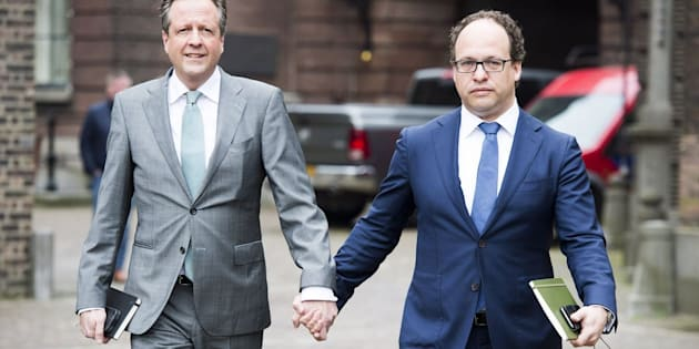 Dutch leader of the Democrats 66 (D66) party Alexander Pechtold (L) and Financial specialist of D66 party Wouter Koolmees (R) arrive for a meeting with other Dutch political parties, in The Hague, on April 3, 2017 while they hold hands as a sign of solidarity for two men who were physical abused after holding hands in public in Arnhem, on 1 April 2017. / AFP PHOTO / ANP / Lex van Lieshout / Netherlands OUT        (Photo credit should read LEX VAN LIESHOUT/AFP/Getty Images)