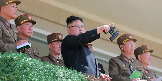 "This undated picture released from North Korea's official Korean Central News Agency on April 14 shows North Korean leader Kim Jong-Un (center) inspecting the ""Dropping and Target-striking Contest of KPA Special Operation Forces - 2017"" at an undisclosed location in North Korea. He has overseen a special forces commando operation, state media said on April 13, as tensions soar with Washington over Pyongyang's nuclear program."