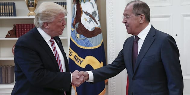 President Donald Trump shakes hands with Russian Foreign Minister Sergei Lavrov as they meet for talks in the Oval Office at the White House.