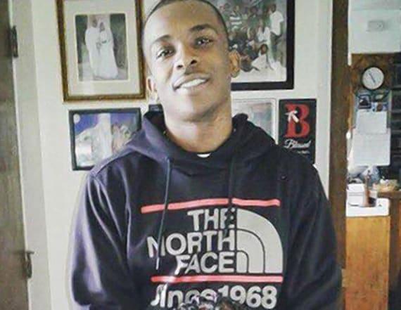 Unarmed black man shot to death in own backyard