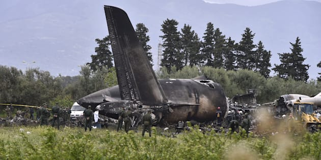 Rescuers are seen around the wreckage of an Algerian army plane which crashed near the Boufarik airbase, from where the plane had taken off, on April 11, 2018.