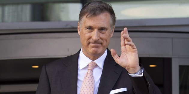 Maxime Bernier leaves the building after filing the papers for the Peoples Party of Canada at the Elections Canada office in Gatineau, Que. on Oct. 10, 2018.