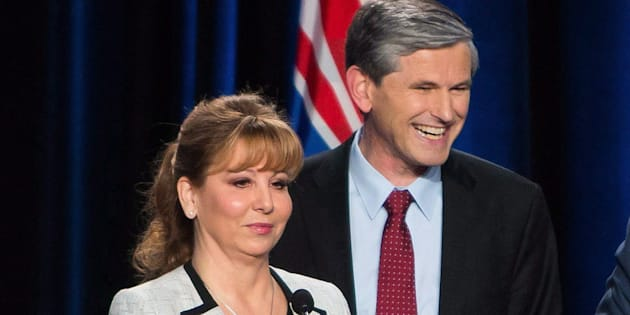 Dianne Watts and Andrew Wilkinson take a break during a leadership debate in Vancouver on Jan. 23, 2018.