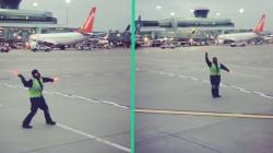 Cet employé d'aéroport transforme le tarmac en piste de