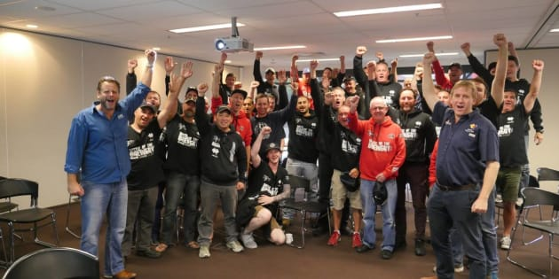 The CUB55 workers celebrate after agreeing to a new deal