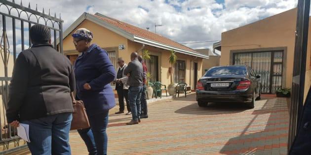Scenes from outside Mandla Hlatshwayo's family home in Chiawelo, Soweto.