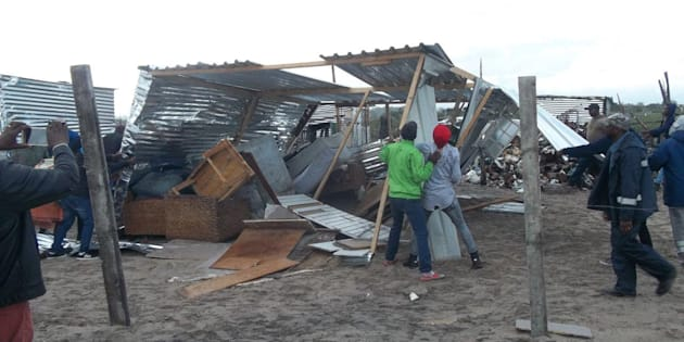 Residents of Siyahlala informal settlement tore down this shack because an immigrant was living in it with his South African wife.
