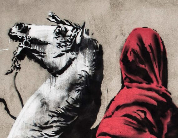 Banksy paints Paris with murals about immigration