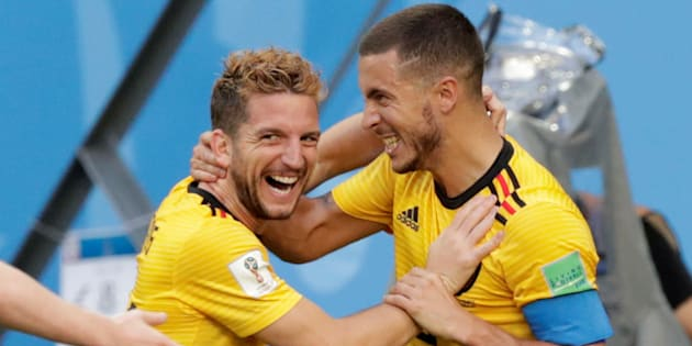 Belgium's Eden Hazard celebrates scoring their second goal against England with Dries Mertens on Saturday.