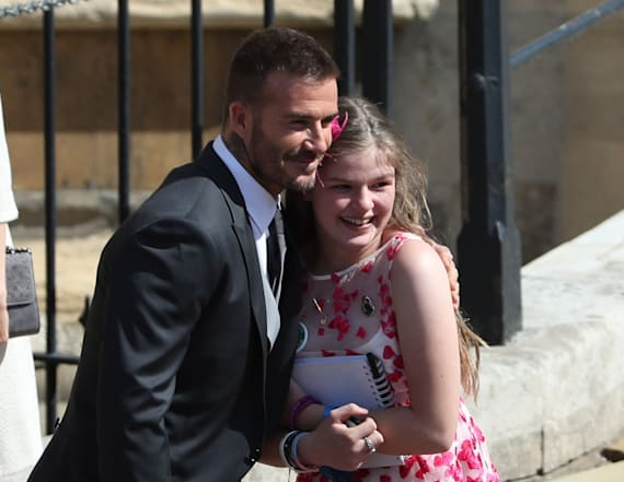 Manchester survivor shares a hug with David Beckham