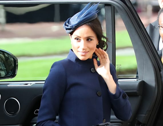 Duchess Meghan stuns in navy at Eugenie's wedding