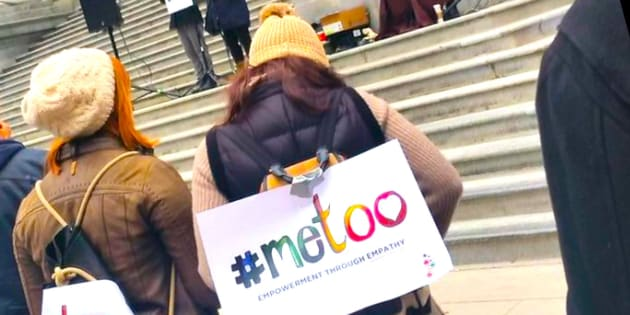 Protesters attend a #MeToo rally outside of the Vancouver Art Gallery on Saturday.