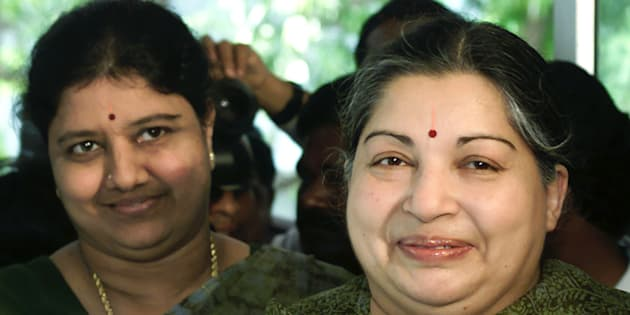 File photo of former filmstar and powerful regional politician Jayaram Jayalalitha (C), leader of the opposition AIADMK party alliance, with her companion Sasikala Natarajan (L) in Madras, May 10, 2001.