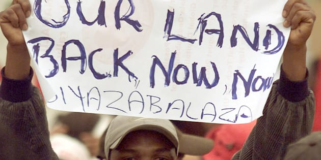 Demonstrators demand land during a march outside the opening session of the World Conference Against Racism in Durban, on August 31, 2001.