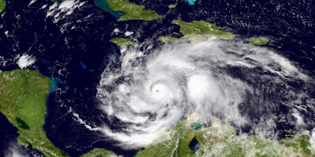 CARIBBEAN SEA - OCTOBER 2: In this NOAA handout image, taken by the GOES satellite at UTC: 1803Z shows Hurricane Matthew in the Caribbean Sea just south of Cuba and Jamacia on October 2, 2016. Matthew is a strong Category 4 hurricane, in the central Caribbean Sea and is poised to deliver a potentially catastrophic strike on Haiti.  (Photo by NOAA via Getty Images)