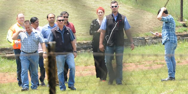 Ajay Gupta (in the red shirt and sunglasses) and Ronica Ragavan (in the pink shirt) at Optimum coal mine on February 07, 2018 in Middelburg.