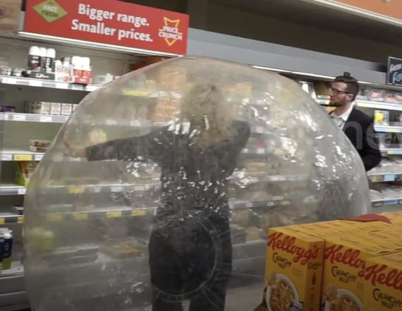 Woman goes grocery shopping inside giant bubble