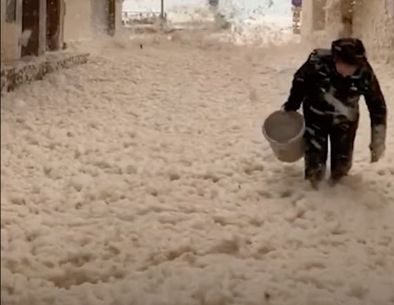 Residents film Spanish streets flooding with seafoam