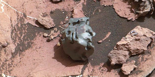 This image photographed by NASAs Curiosity Mars Rover on Oct 30 2016 shows a dark smoothsurfaced object After the golf ballsized object was examined by laser pulses from Curiosity it was determined to be an ironnickel meteorite The object has been nicknamed Egg Rock after an historic area of Bar Harbor Maine