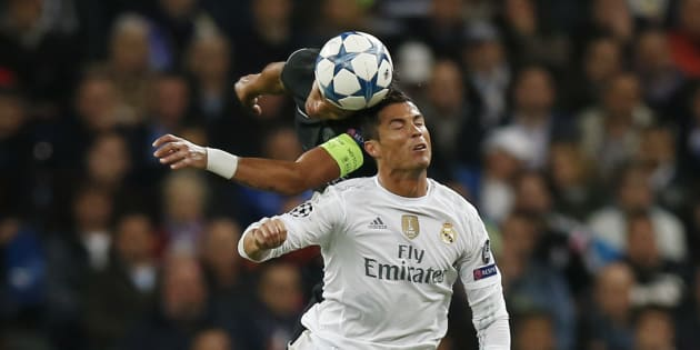 Paris St Germain's Thiago Silva in action with Real Madrid's Cristiano Ronaldo.