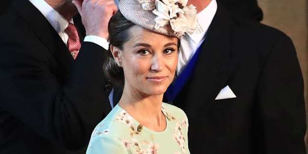 Pippa Middleton arrives at St George's Chapel at Windsor Castle for the wedding of Prince Harry to Meghan Markle on May 19, 2018 in Windsor, England.