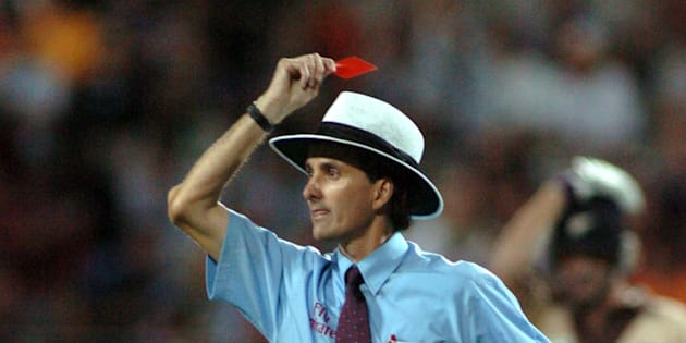 AUCKLAND, NEW ZEALAND - FEBRUARY 17:  Umpire Billy Bowden shows Australian bowler Glen McGrath (not in picture) a red card