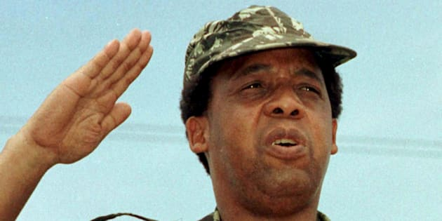 South African Communist Party leader Chris Hani salutes at a rally of the African National Congress (ANC)  in this file picture taken December 16, 1991.