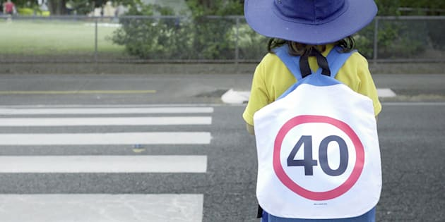 Students at Junction Park State School were handed 40km speed sign backpacks as school holidays ends.