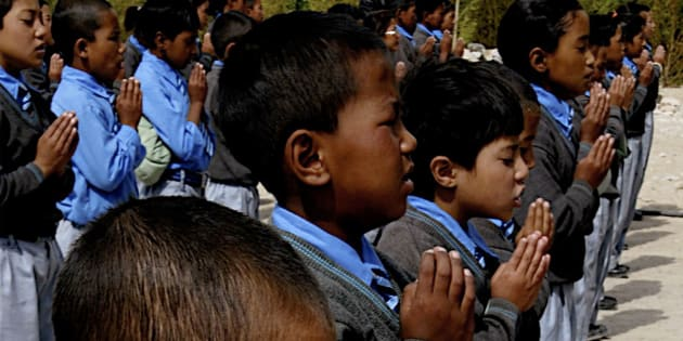School children attend their morning assembly inside a charity school in Leh district of Buddhist dominated Ladakh region in the Indian state of Jammu and Kashmir.
