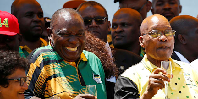 African National Congress (ANC) President Cyril Ramaphosa (L) reatcs as he celebrates the Congress' 106th anniversary celebrations with President of South Africa Jacob Zuma, in East London, South Africa, January 13, 2018.