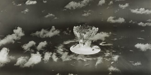 [File photo] A mushroom cloud rises with ships below during Operation Crossroads nuclear weapons test on Bikini Atoll, Marshall Islands, in 1946.