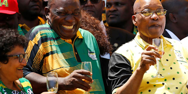 African National Congress (ANC) President Cyril Ramaphosa (L) reatcs as he celebrates the Congress' 106th anniversary celebrations with President of South Africa Jacob Zuma, in East London, South Africa, January 13, 2018. REUTERS/Siphiwe Sibeko 2pts