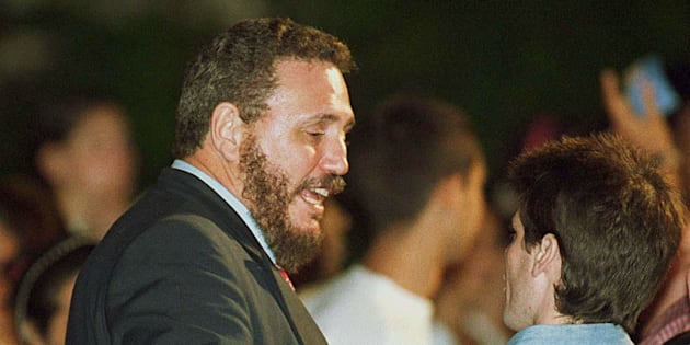 Fidel Castro Diaz-Balart (L), oldest son of Cuban President Fidel Castro, speaks with presidential aid Carlos Valenciaga 09 February, 2000, in Havana, during a rally demanding the return of Elian Gonzalez to Cuba.
