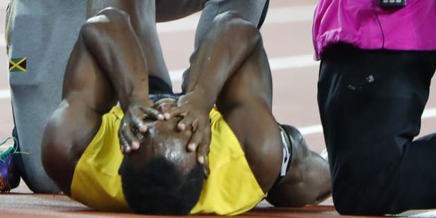 Athletics - World Athletics Championships ? men?s 4 x 100 meters relay final ? London Stadium, London, Britain ? August 12, 2017 ? Usain Bolt of Jamaica reacts after sustaining an injury.
