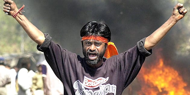 "This famous photo from 2002 shows a Bajrang Dal activist who, years later, called the Gujarat riots a ""mistake"" and apologised for his role in them."