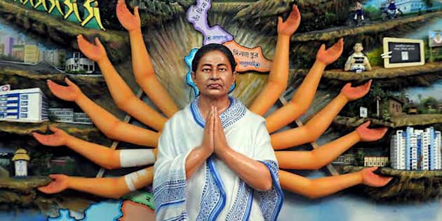 West Bengal Chief Minister Mamata Banerjee shown as Devi Durga at a clay model at a pandal for the upcoming community puja pandal in Nadia district of Bengal on Monday. PTI Photo.