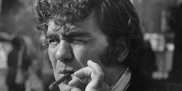 Jimmy Breslin smokes a cigar outside the Madison Hotel in Washington, DC on August 29, 1973.