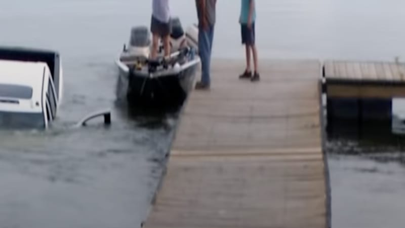 Watch this GMC Sierra pickup slide down a boat launch into a lake