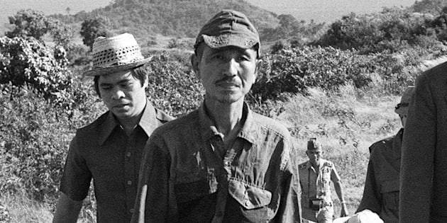 This picture taken on March 11, 1974 shows former Japanese imperial army soldier Hiroo Onoda (2nd L) walking from the jungle where he had hidden since World War II,  on Lubang island in the Philippines. Onoda, who hid in the Philippine jungle for three decades because he did not believe World War II was over, has died in Tokyo on January 17, 2014, at the age of 91. The former soldier waged a guerilla campaign in Lubang Island near Luzon until he was finally persuaded in 1974 that peace had broken out.   JAPAN OUT     AFP PHOTO / JIJI PRESS        (Photo credit should read JIJI PRESS/AFP/Getty Images)