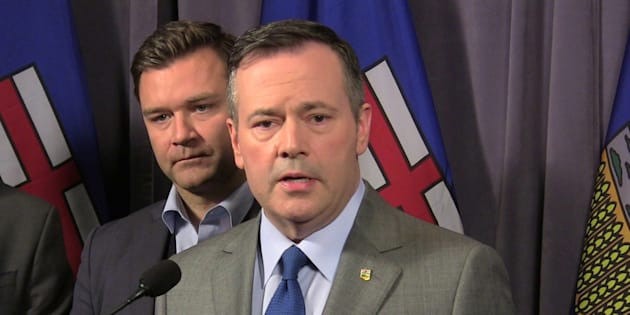 Alberta Opposition United Conservative Leader Jason Kenney speaks to reporters as Edmonton-Riverbend Conservative MP Matt Jeneroux looks on at the party's founding convention at the Sheraton Hotel in Red Deer, Alberta on Friday.