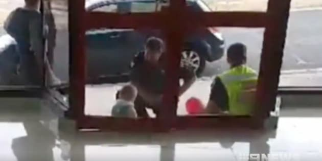 Police comforted the child after rescuing him.